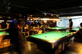Playing pool and hanging out at Fat Cat in New York.