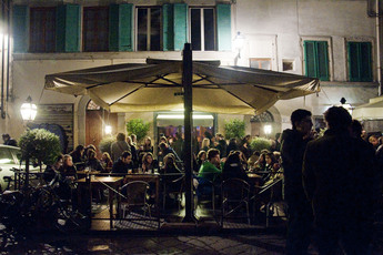 People drinking and chatting the night away at Cabiria in Florence.