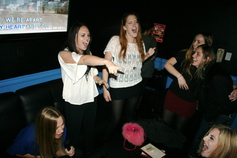 Belting out classics at Pandora Karaoke!