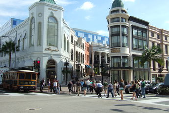 Crowds of people enjoying (and spending all their money at) the shops on Rodeo Drive in Beverly Hills.