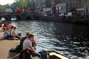 Hanging out by the canals on a sunny day in Amsterdam.