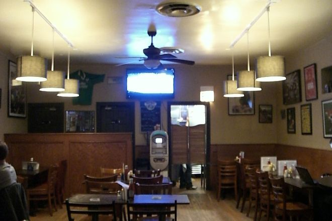 The back of the bar at Paddy Long&#x27;s with entrance to kitchen, ATM, and bathrooms.