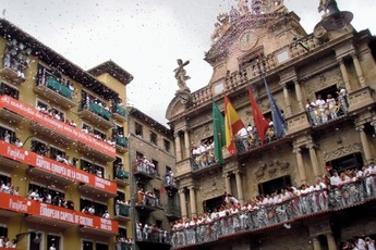 Cheering from the balconies in Pamplona.