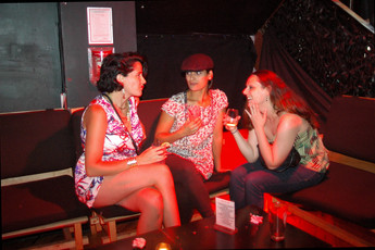 Girls hanging out and chatting at (le) poisson rouge in New York.