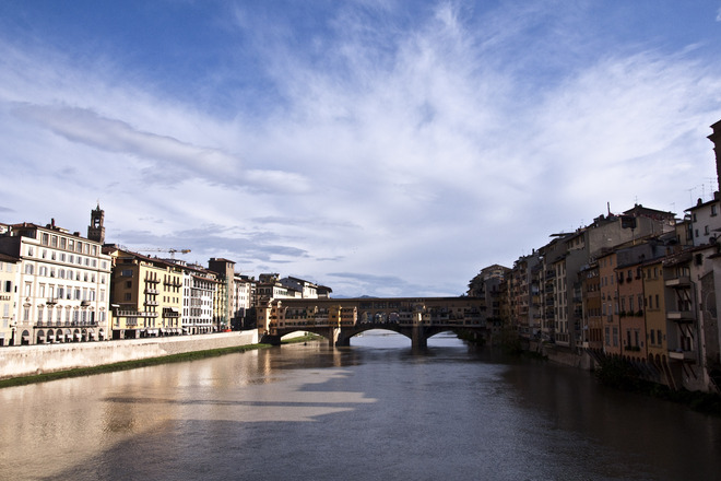 View of Ponte Vecchio and Arno River from Ponte Santa Trinita in Florence.